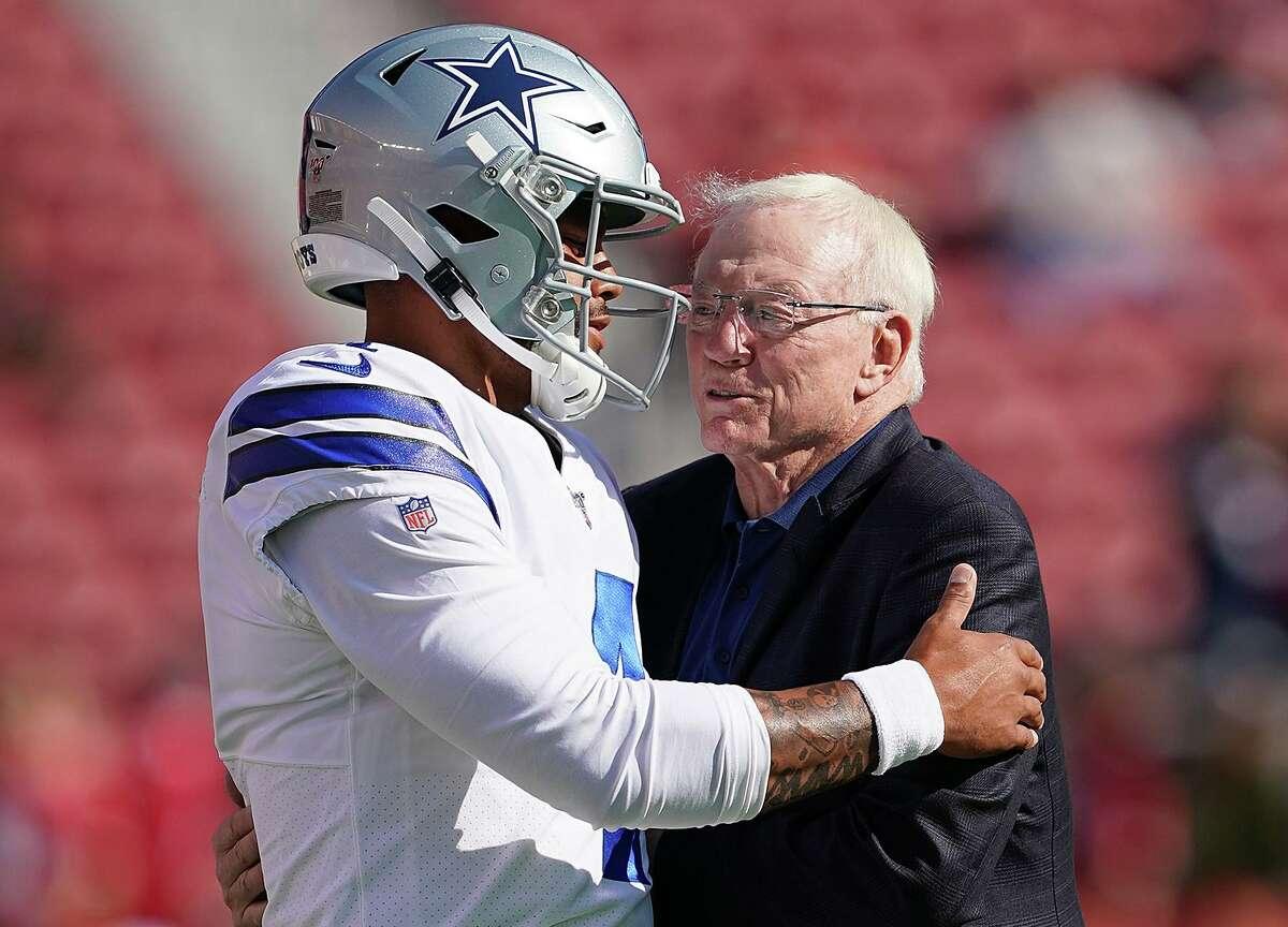Dallas Cowboys quarterback Dak Prescott, left, and team owner Jerry Jones.