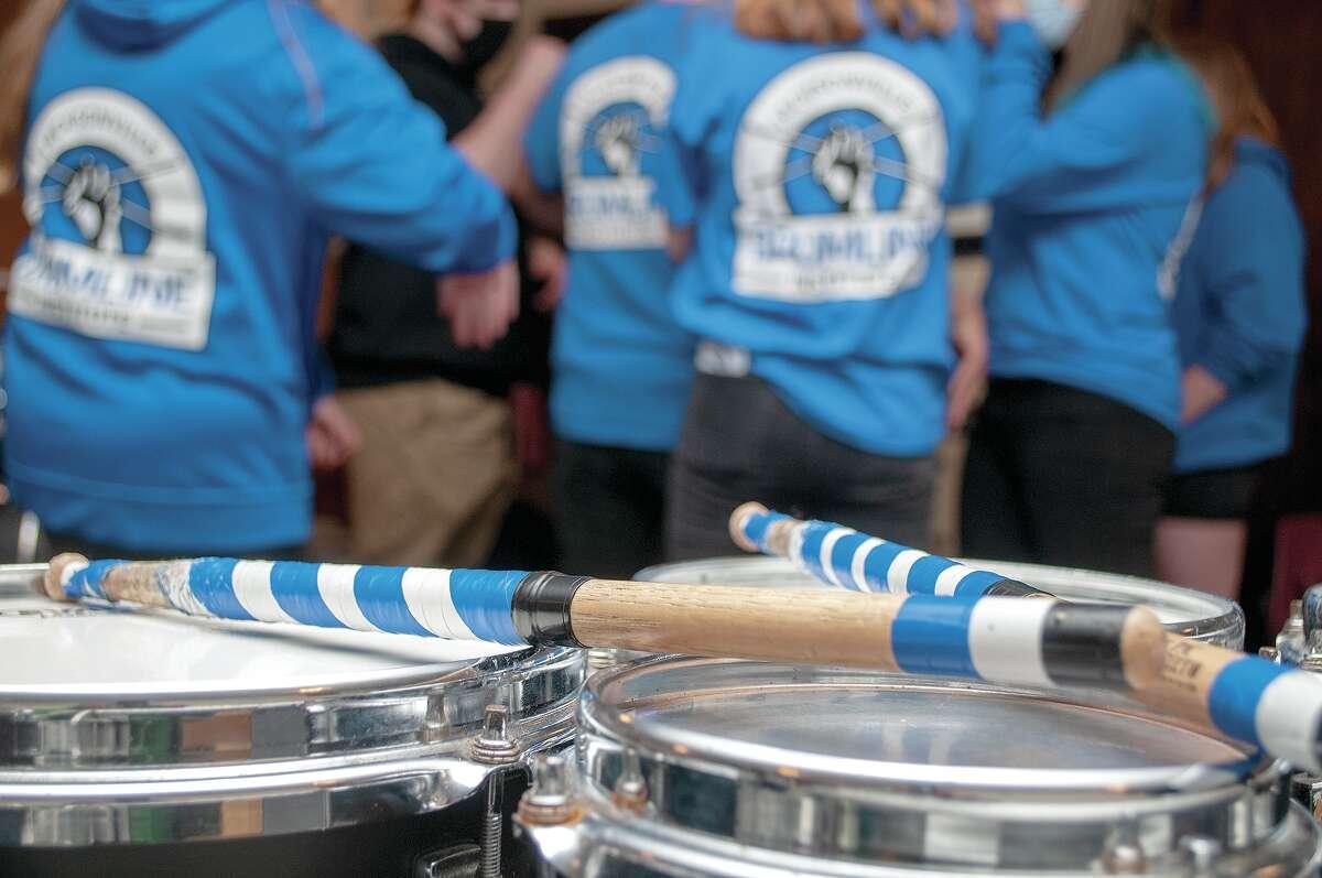 Drumsticks rest on a drumset as Jacksonville Drumline Institute students take a break during practice.