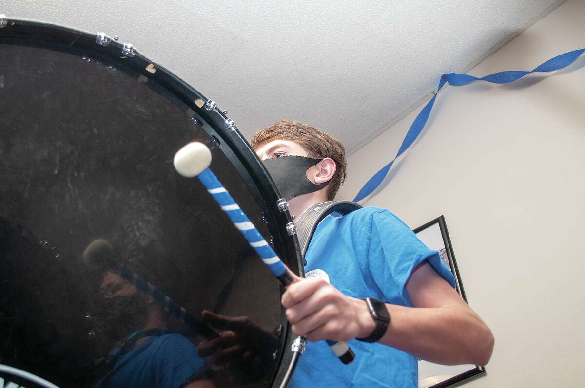 Jason Timmons plays the bass drum during a Jacksonville Drumline Institute practice sessions at First Baptist Church on Mound Road.