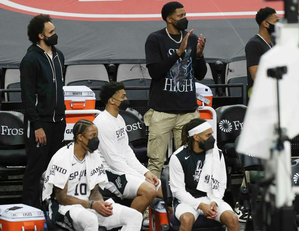 Spurs' Derrick White (top left) and Rudy Gay (top right) were seen with the team but not in uniform as the Spurs played against the New York Knicks at the AT&T Center on Tuesday, Mar. 2, 2021. Spurs defeated the Knicks, 119-93.