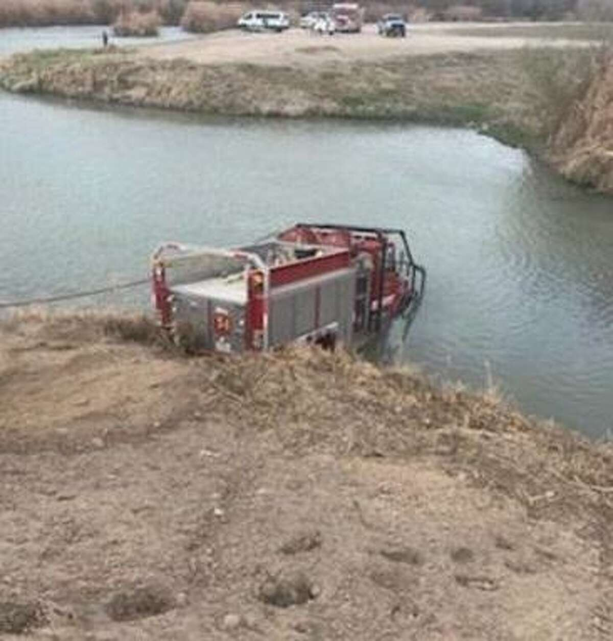 A Laredo Fire Department tanker truck rolled into the Rio Grande in the El Azteca neighborhood due to a malfunction while firefighters were battling a grass fire. No injuries were reported.