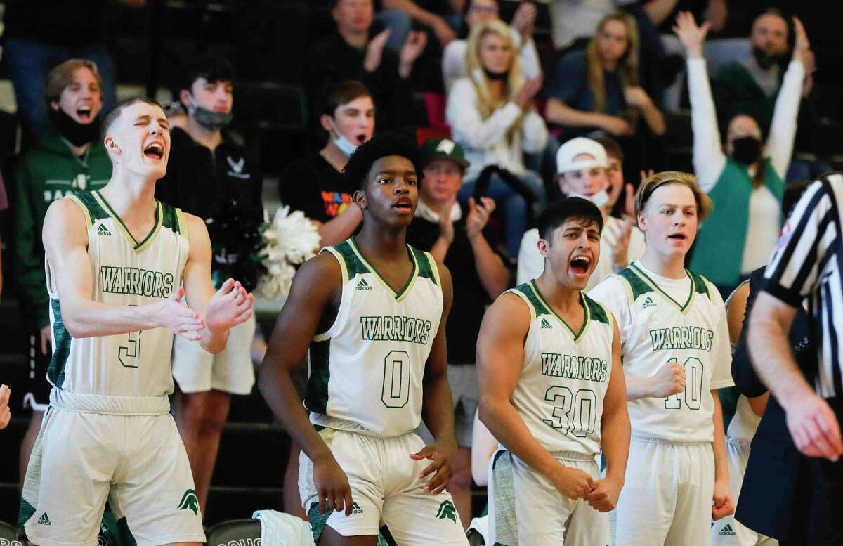 TWCA's bench celebrates during the fourth quarter of a TAPPS Class 5A regional playoff game at College Station High School, Saturday, March 6, 2021, in College Station.