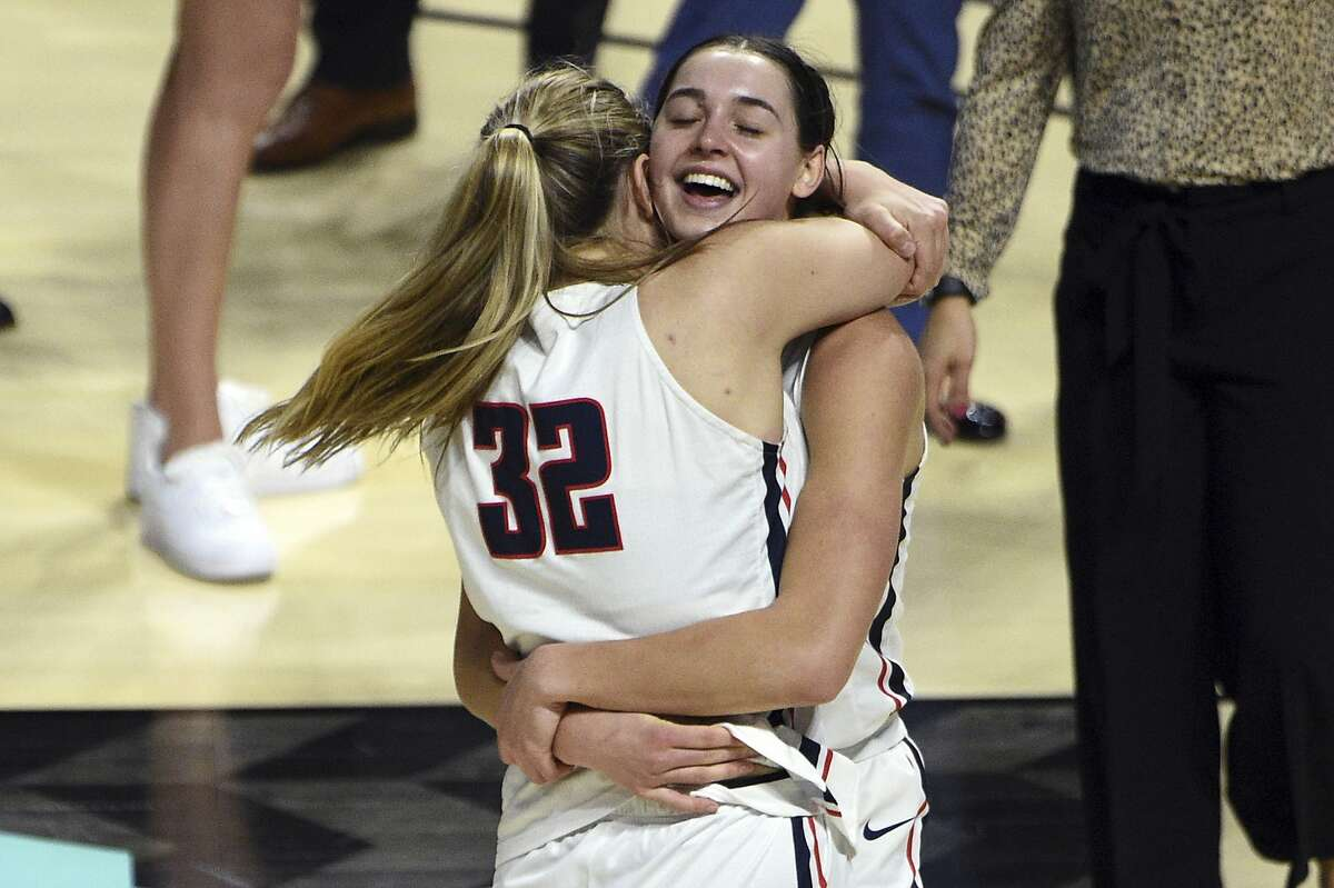 Gonzaga guard Jill Townsend (32) and forward Jenn Wirth embrace after Townsend's jumper upended BYU.