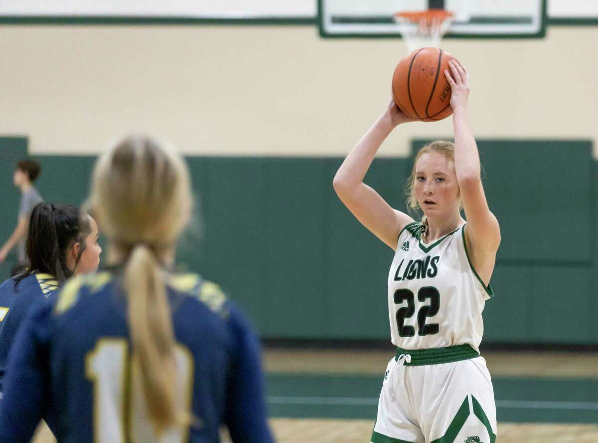 FILE - Legacy Preparatory Christian Academy Trinity Reifsteck (22) looks for an opening to pass the ball during the third quarter of a TAPPS Class 4A Area girls basketball game against Westbury Christian at Legacy Preparatory Christian Academy, Tuesday, March 02, 2021, in Magnolia.