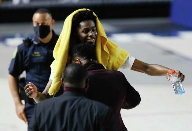 Beaumont United small forward Terrance Arceneaux (23) smiles after defeating Leander Glenn 82-57 during a Region III-5A state semifinal game at Delmar Fieldhouse, Tuesday, March 9, 2021, in Houston. Photo: Jason Fochtman, Houston Chronicle / Staff Photographer / 2021 © Houston Chronicle