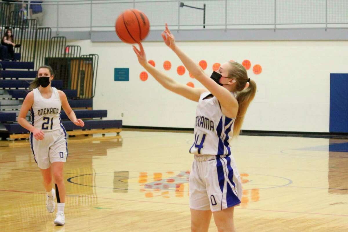 Madison Gutowski fires an outside jumper during Onekama's win over North Bay on March 9. (Robert Myers/News Advocate)