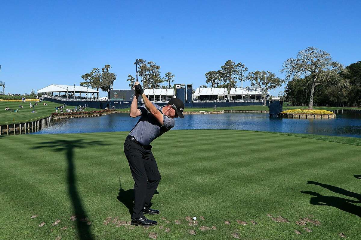 Jimmy Walker plays a shot on the 17th hole during Tuesday's practice round at TPC Sawgrass.