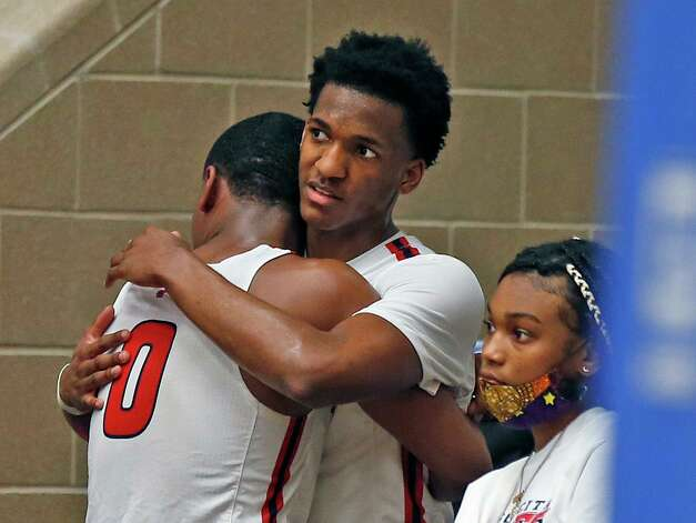 Atascocita Tom Hart III #0 is consoled by a teammate at the end of the game. Atascocita vs. Austin Westlake at North Side ISD gym in boys Class 6A on Tuesday, March 9, 2021 Photo: Ronald Cortes/Contributor / 2021 Ronald Cortes