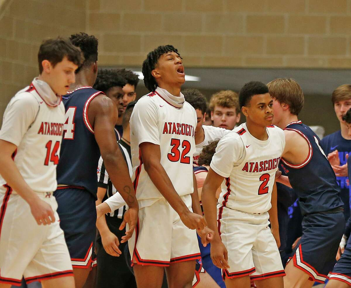 Atascocita Kaleb Pouncy #32 and teammates reacts after a turnover. Atascocita vs. Austin Westlake at North Side ISD gym in boys Class 6A on Tuesday, March 9, 2021