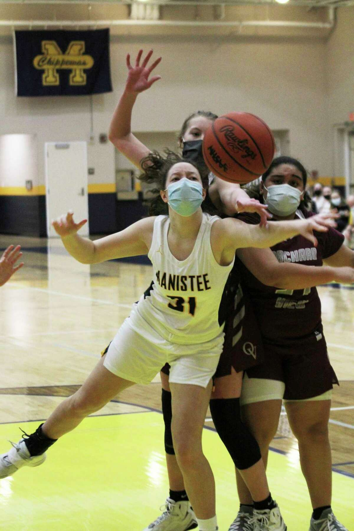 Manistee's Abigail Robinson eyes a loose ball Tuesday night in the Chippewas' victory over Orchard View. (Dylan Savela/News Advocate)