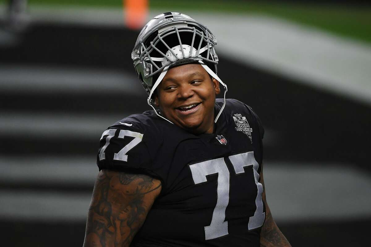 Offensive tackle Trent Brown #77 of the Las Vegas Raiders looks on during the first half against the Los Angeles Chargers at Allegiant Stadium on Dec. 17, 2020 in Las Vegas, Nevada. (Ethan Miller/Getty Images/TNS)