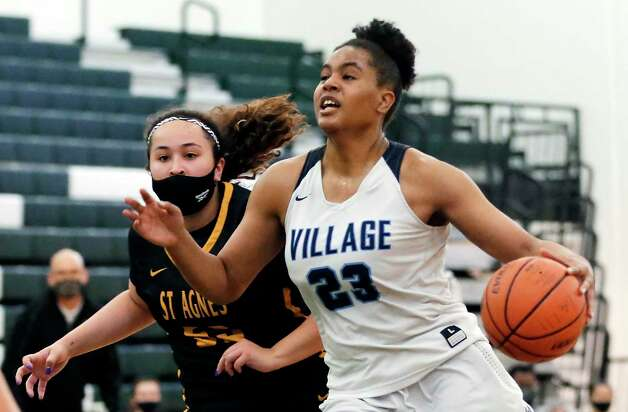 Village School's Jada Malone led all scorers with 20 points in the Vikings' 61-33 state semifinal victory over St. Agnes on Tuesday night. Photo: Michael Wyke / Contributor / © 2021 Houston Chronicle