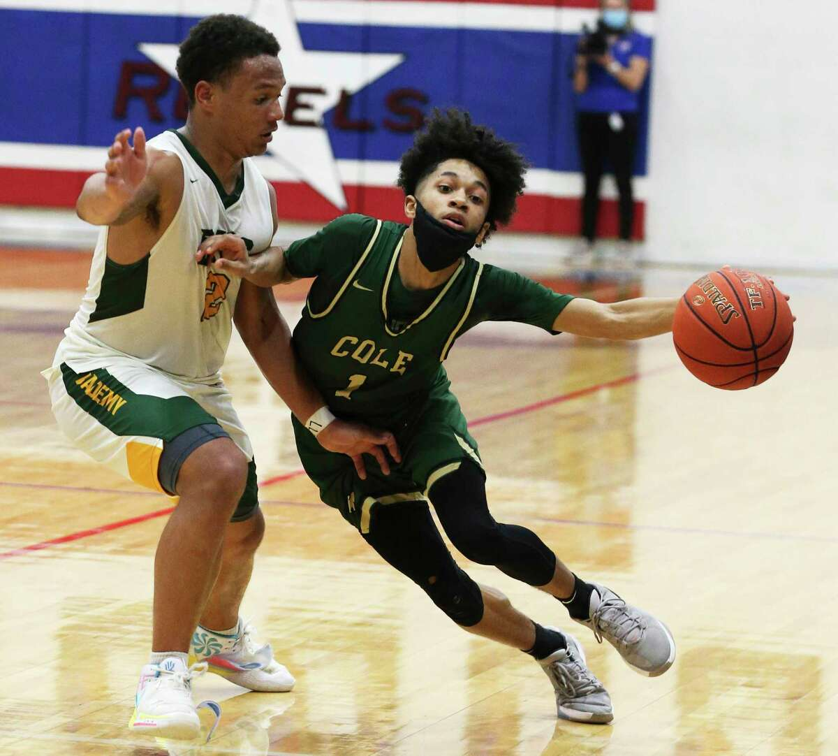 Cole's Silas Livingston (01) drives around Little River Academy's Darion Franklin (02) during the Class 3A state semifinal basketball game in Buda on Tuesday, Mar. 9, 2021. Cole defeated Academy, 59-50, to return the state finals.
