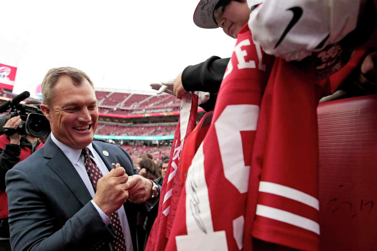 San Francisco 49ers general manager John Lynch autographs jerseys for fans before the NFC Championship Game against the Green Bay Packers at Levi's Stadium, Sunday, Jan. 19, 2020, in San Francisco, Calif.