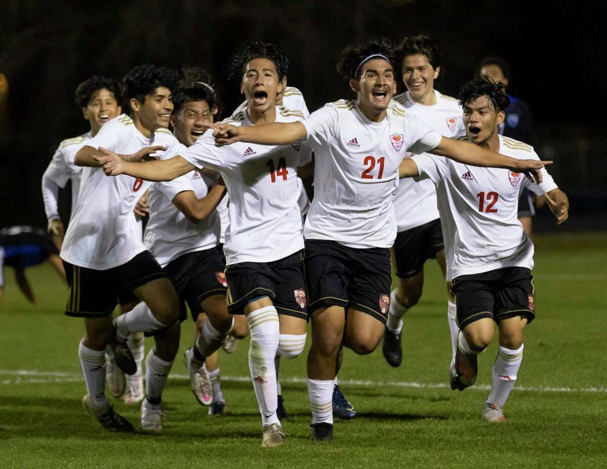 Caney Creek soccer players celebrate after Mario Leon's game-winning goal with 15 seconds to play in a District 20-5A boys soccer match at Don Ford Stadium, Tuesday, March 9, 2021, in New Caney.