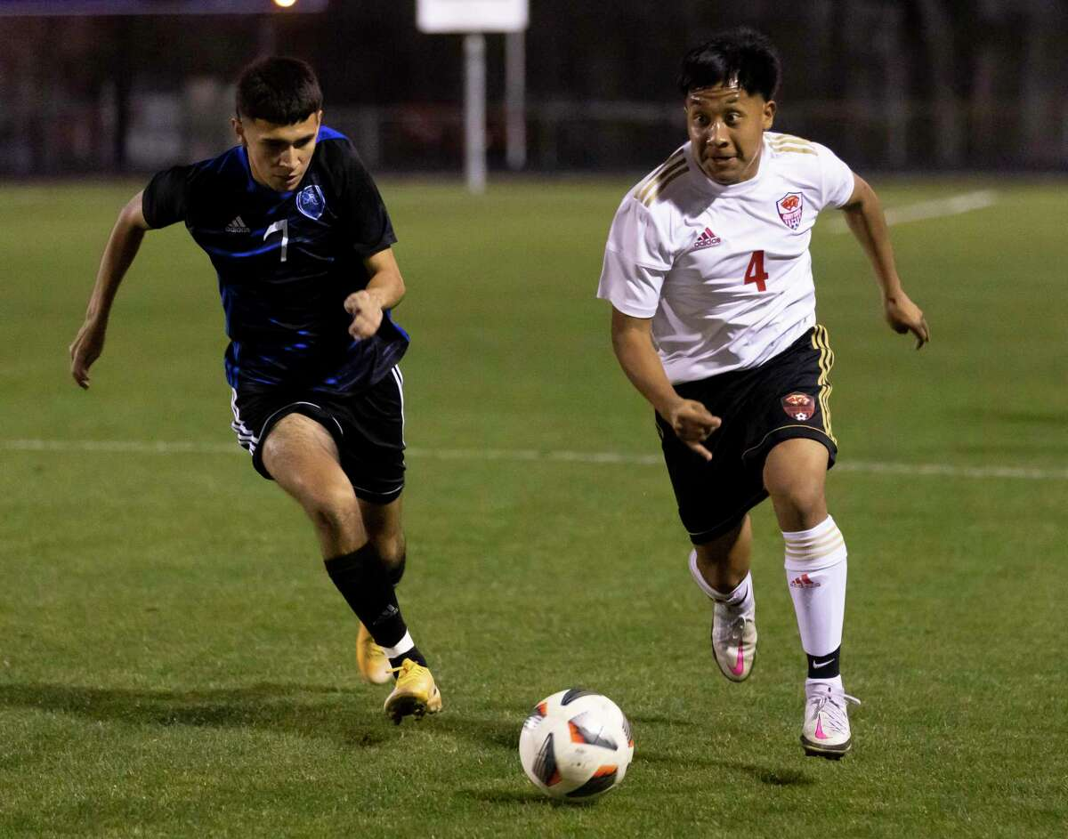 Caney Creek's Jose Balderas (4) and New Caney's Fernando Saldana (7) run toward a loose ball during the first half of a District 20-5A boys soccer match at Don Ford Stadium, Tuesday, March 9, 2021, in New Caney.