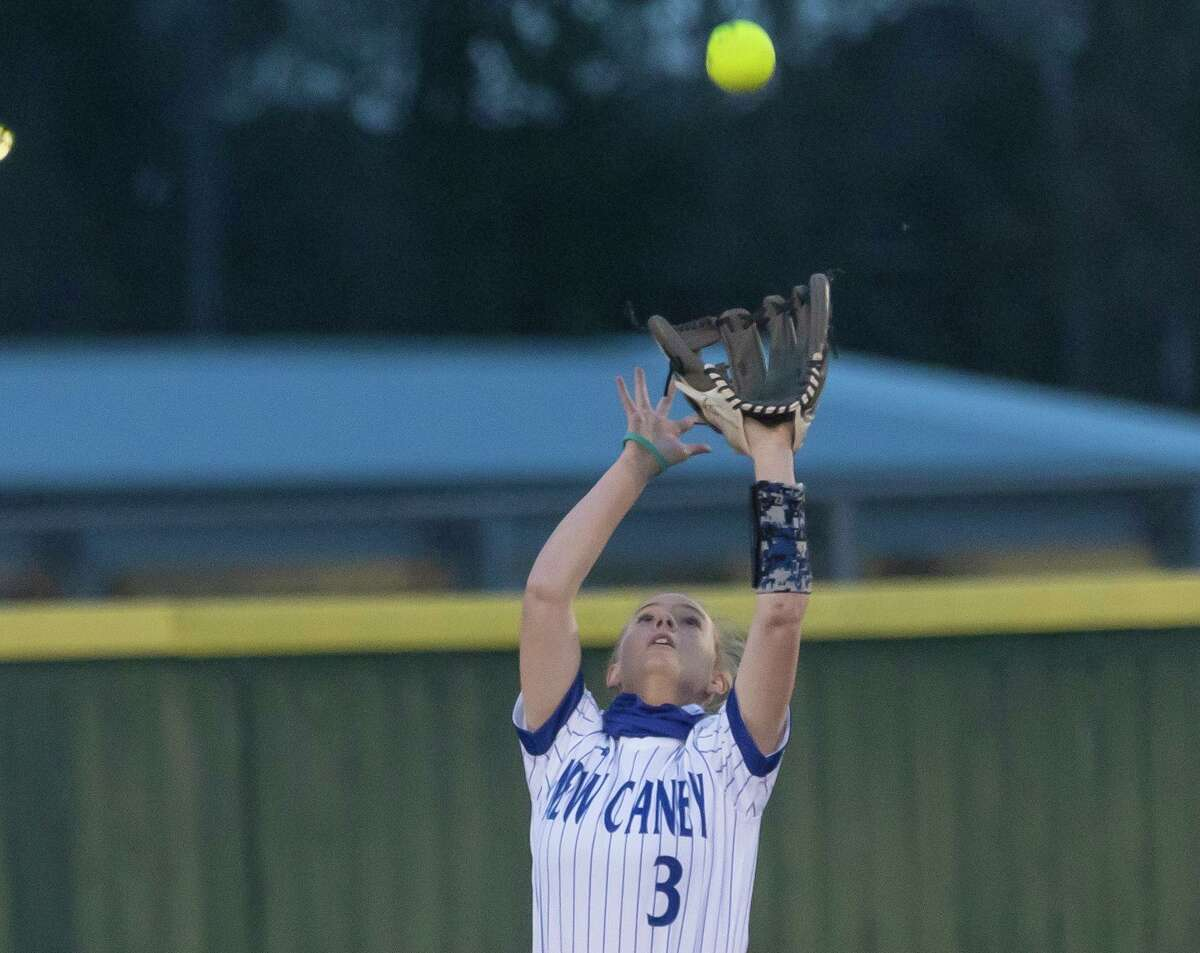 New Caney's Jackie Walter (3) catches a foul ball during the second inning of a District 20-5A softball game against Lake Creek at New Caney Middle School, Tuesday, March 9, 2021, in New Caney.