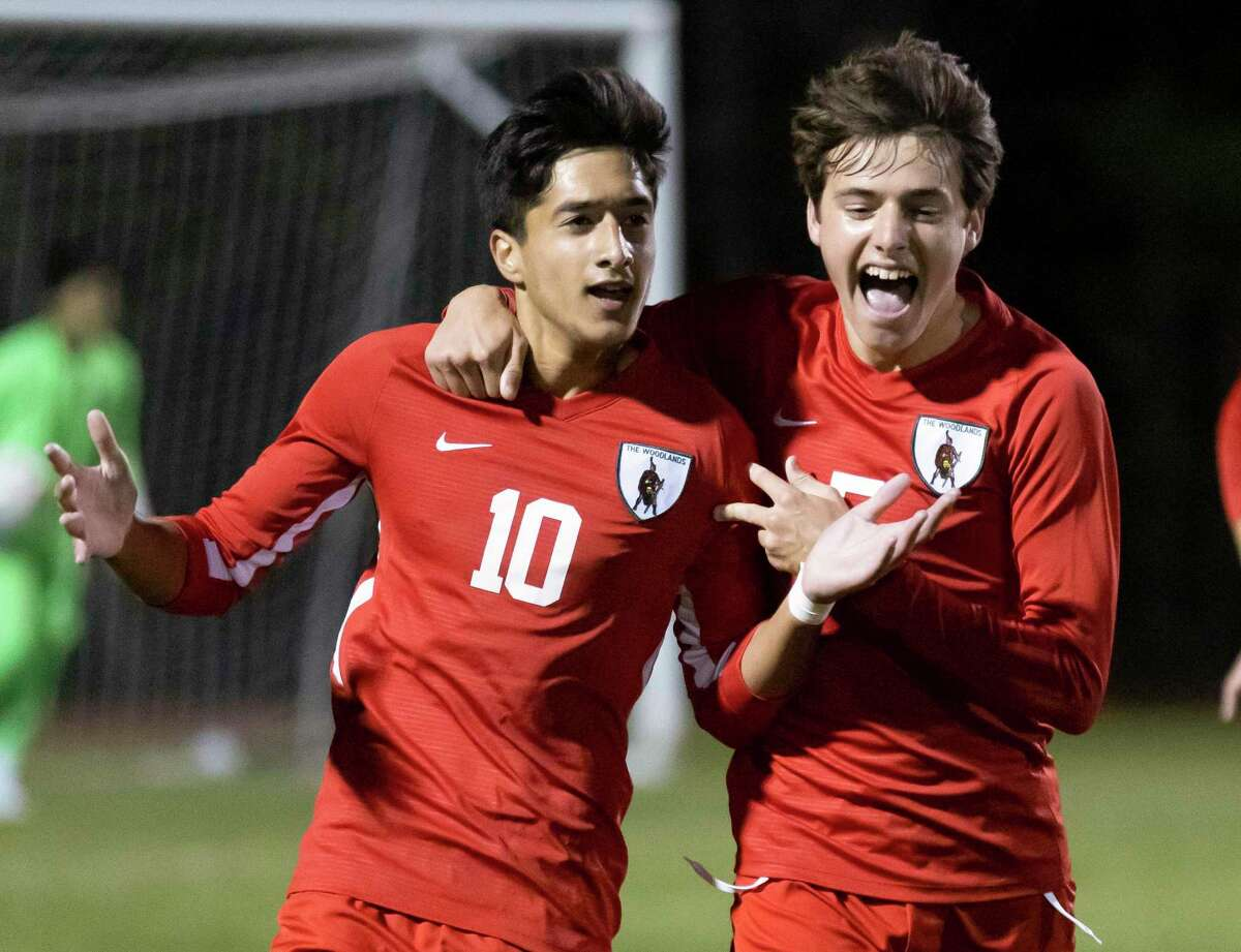 FILE - The Woodlands midfielder Andrew Davison (5) and midfielder Hasan Arif (10) react after they score during the first half of a District 13-6A boys soccer against Conroe at The Woodlands High School, Tuesday, Feb. 23, 2021, in The Woodlands.