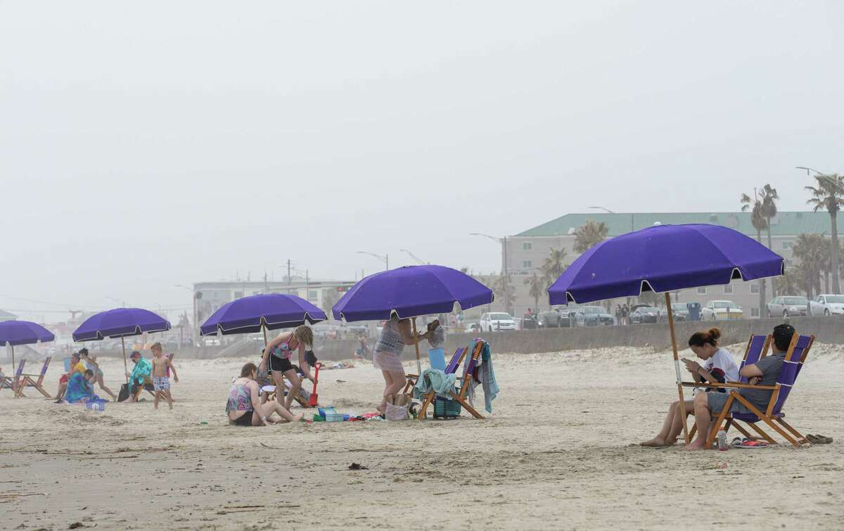 Beach chairs and umbrellas can be rented along the beach Thursday, March 11, 2021, in Galveston, Texas.