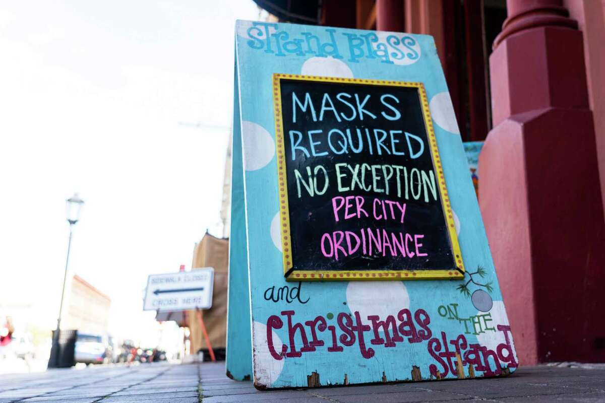 A shop on The Strand has a sign saying that masks are required on Tuesday, March 9, 2021, in Galveston. The island is preparing for the start of Spring Break next week.