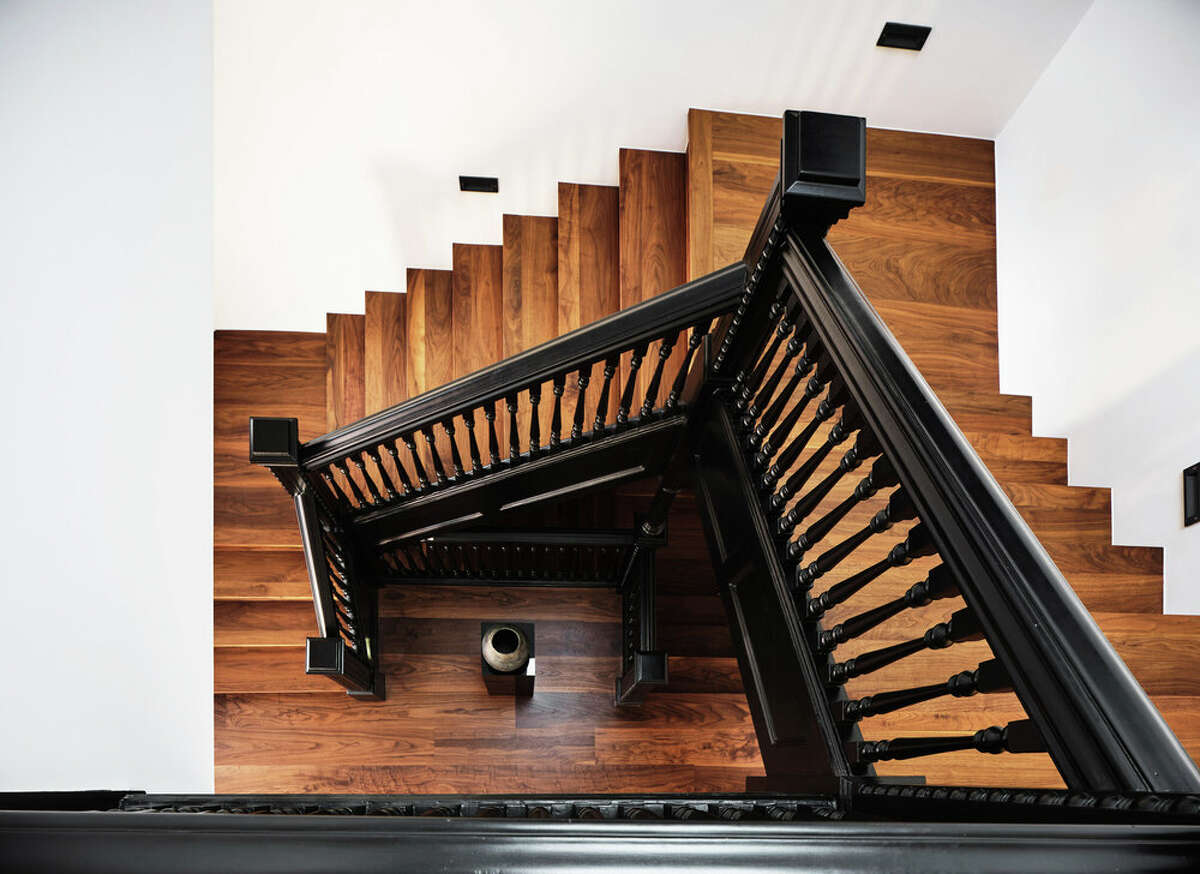 One of the few original features to remain is the central staircase banister, which provides a striking contrast to the modern look of the rest of the home.
