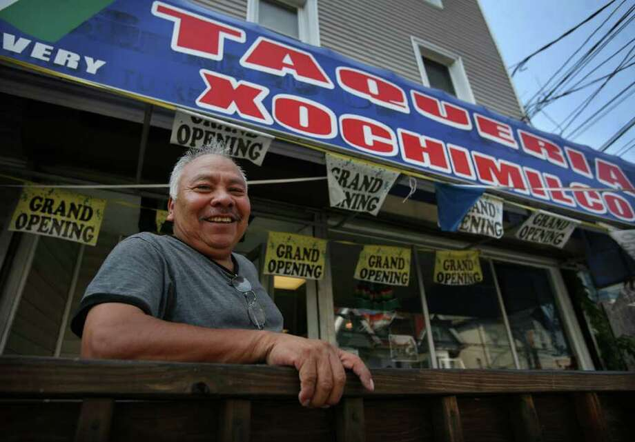 Eleuterio Rivera outside his new business, Taqueria Xochimilco at 243 Madison Avenue in Bridgeport. Photo: Brian A. Pounds / Connecticut Post