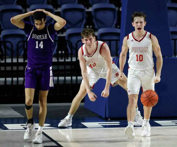 Huffman point guard Jacob Harvey (10) reacts beside teammate Grey Soileau (40) after drawing a charge against Boerne point guard Joaquin Gonzalez (14) during the fourth quarter of a Region III-4A state semifinal game at Delmar Fieldhouse, Tuesday, March 9, 2021, in Houston. Huffman defeated Boerne 55-49. Photo: Jason Fochtman, Staff Photographer / 2021 © Houston Chronicle