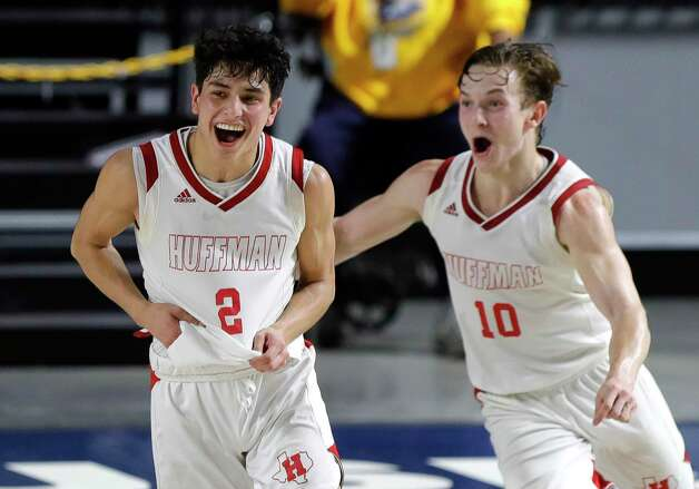 Huffman's Gabe Cardenas (2) and point guard Jacob Harvey (10) celebrate after defeating Boerne 55-49 during a Region III-4A state semifinal game at Delmar Fieldhouse, Tuesday, March 9, 2021, in Houston. Photo: Jason Fochtman, Staff Photographer / 2021 © Houston Chronicle