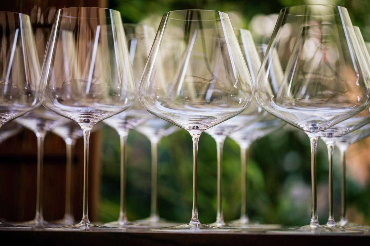 Polished wine glasses are seen in the Ken Fulk-designed 'Usu-Zan' outdoor dining room at SingleThread in Healdsburg, California on Sunday, March 7, 2021.