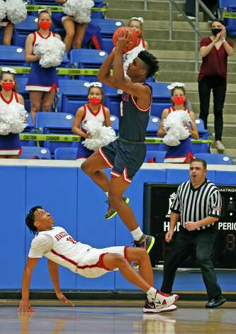 Atascocita Christian Asahby #11 is called for a block on Westlake Kj Adams #24.  Atascocita vs. Austin Westlake at North Side ISD gym in boys Class 6A on Tuesday, March 9, 2021 Photo: Ronald Cortes/Contributor / 2021 Ronald Cortes