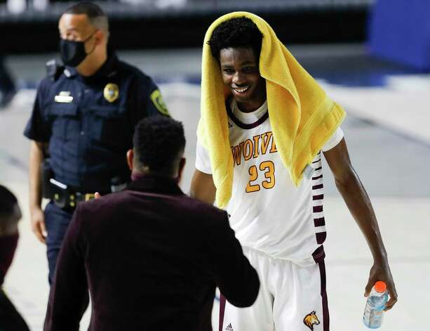 Beaumont United small forward Terrance Arceneaux (23) smiles after defeating Leander Glenn 82-57 during a Region III-5A state semifinal game at Delmar Fieldhouse, Tuesday, March 9, 2021, in Houston. Photo: Jason Fochtman, Staff Photographer / 2021 © Houston Chronicle