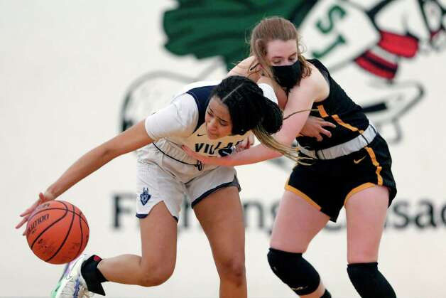 Village's Sydney Ward, left, and St. Agnes' Abbey Lord, right, battle for a loose ball during their TAPP Girls state semi final game at Strake Jesuit Tuesday, Mar. 9, 2021 in Houston, TX. Photo: Michael Wyke, Contributor / © 2021 Houston Chronicle