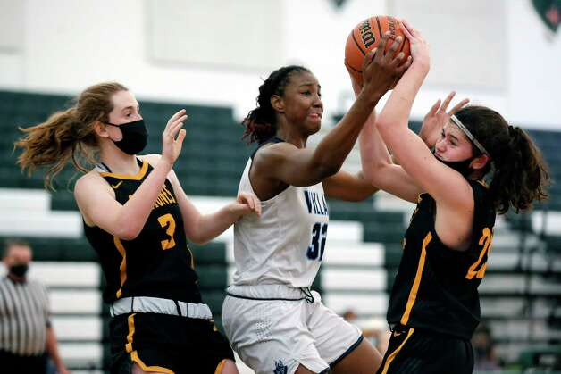 Village's Rylee Grays (32) battles for a rebound with St. Agnes' Abbey Lord (3) and Ella Smith, right, during their TAPP Girls state semi final game at Strake Jesuit Tuesday, Mar. 9, 2021 in Houston, TX. Photo: Michael Wyke, Contributor / © 2021 Houston Chronicle