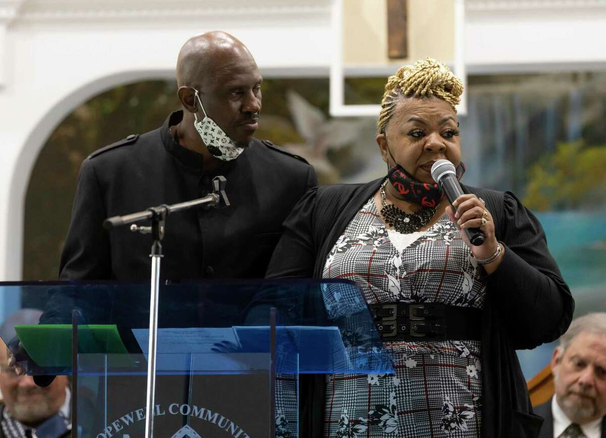 Pastor Taylor Milton, left and his wife Daisy thank all the congregants and people in charge of the church's rebuild during a church dedication ceremony at Hopewell Community Church, Saturday, March 9, 2021, in Conroe. In May 2016 a pecan tree crashed down on the church during a storm forcing congregants to meet at the Conroe Towers and other locations until the newly built 5,000 square foot church was opened.