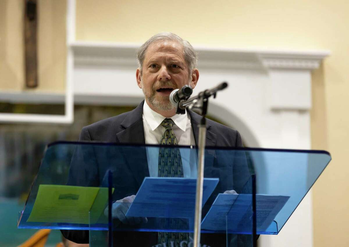 David Staat speaks during a church dedication ceremony at Hopewell Community Church, Saturday, March 9, 2021, in Conroe. Staat offered to do more outreach after a pecan tree crashed down on the church during a storm in May 2016 forcing congregants to meet at the Conroe Towers and other locations until the newly built 5,000 square foot church was opened.