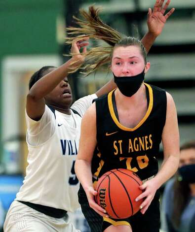 St. Agnes' Sammy Meyers (20) looks to pass the ball in front of Village's Tymberlin Criswell, left,  during their TAPP Girls state semi final game at Strake Jesuit Tuesday, Mar. 9, 2021 in Houston, TX. Photo: Michael Wyke, Contributor / © 2021 Houston Chronicle