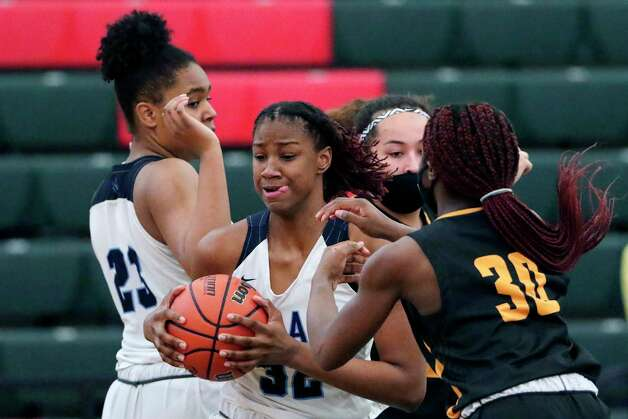 Village's Rylee Grays (32) pulls in a rebound from St. Agnes' Chinelo Umeh (30) during their TAPP Girls state semi final game at Strake Jesuit Tuesday, Mar. 9, 2021 in Houston, TX. Photo: Michael Wyke, Contributor / © 2021 Houston Chronicle