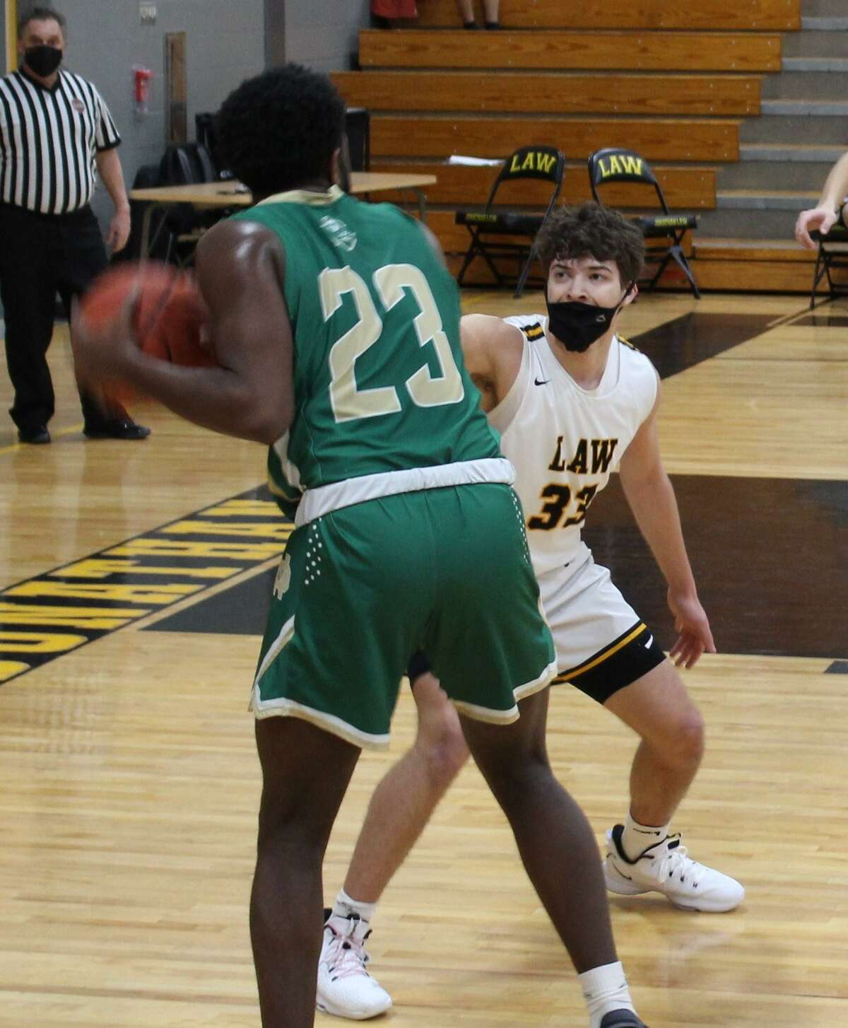 Brian Felag defends Notre Dame's James Rawlins in Law's 46-43 win over the Green Knights.