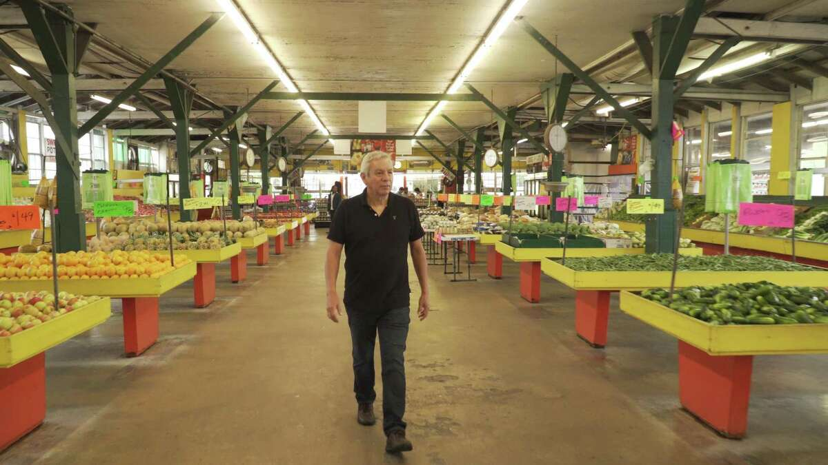 """Adán Medrano enters the Houston Airline Farmers Market in the opening scene of the documetary feature film, """"Truly Texas Mexican."""""""