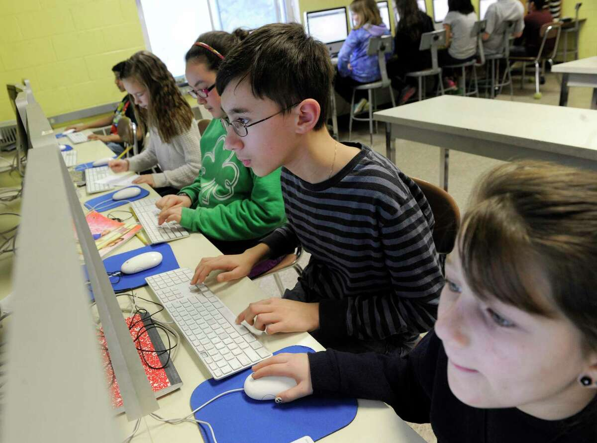 Students at work on their computers as part of trainings Johnson School in Bethel, Conn. gave students for the new state online tests, called Smarter Balanced Assessment, Friday, Feb. 21, 2014.