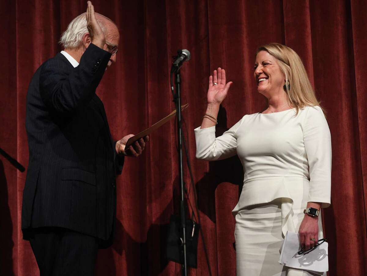 Newly elected Fairfield First Selectwoman Brenda Kupchick is sworn in by former U.S. Rep. Christopher Shays during the Oath of Office Ceremony at Warde High School in Fairfield, Conn. on Monday, November 25, 2019.