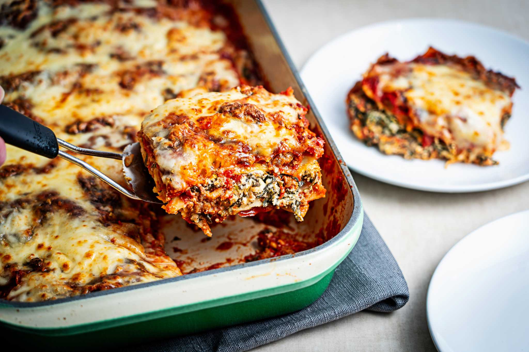 Give lasagna a boost of bold flavors with hot Italian sausage and tangy goat cheese