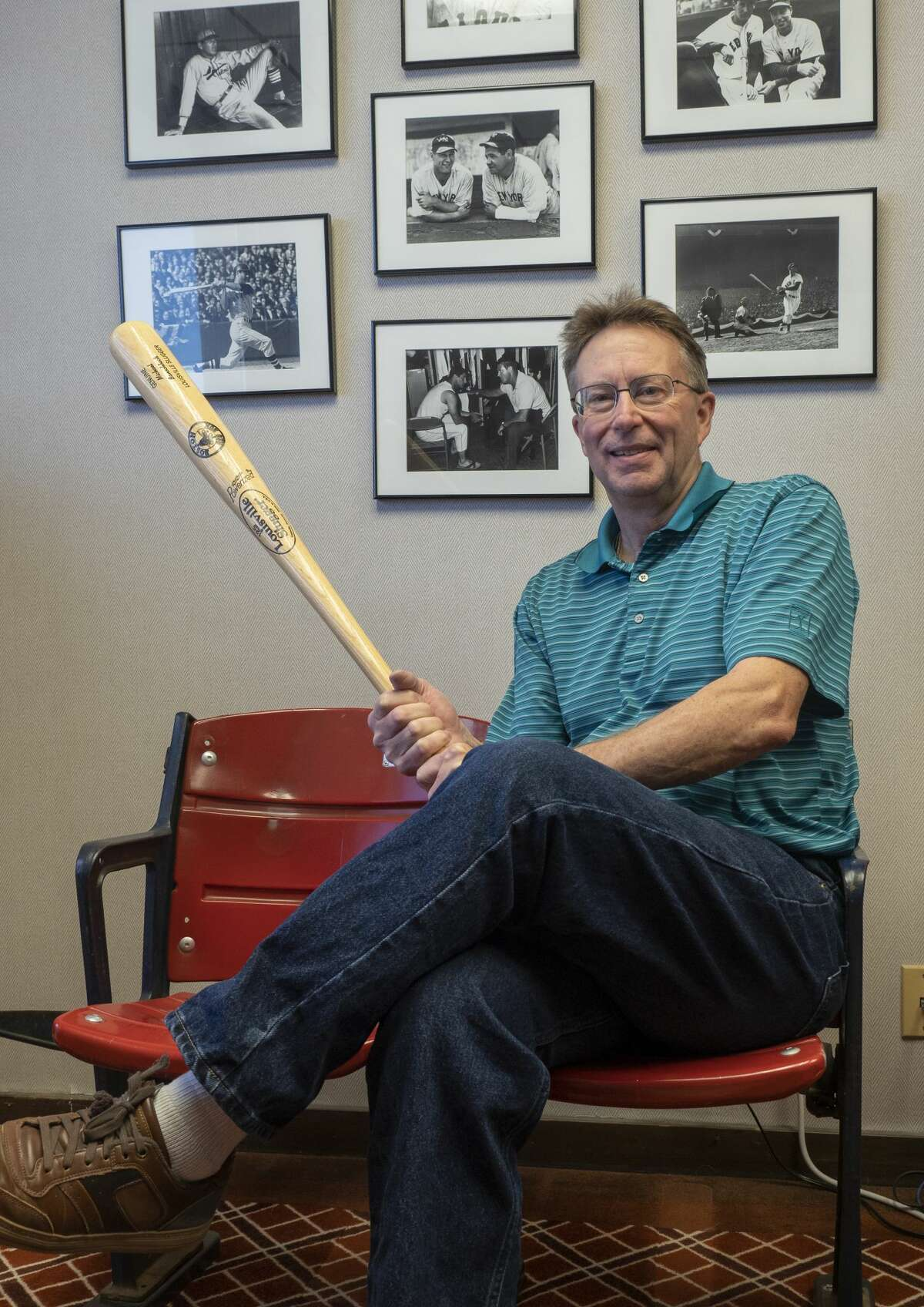 Michael Banschbach an avid baseball collector, sits in his Fenway Park bleacher seats in this picture from January 12.