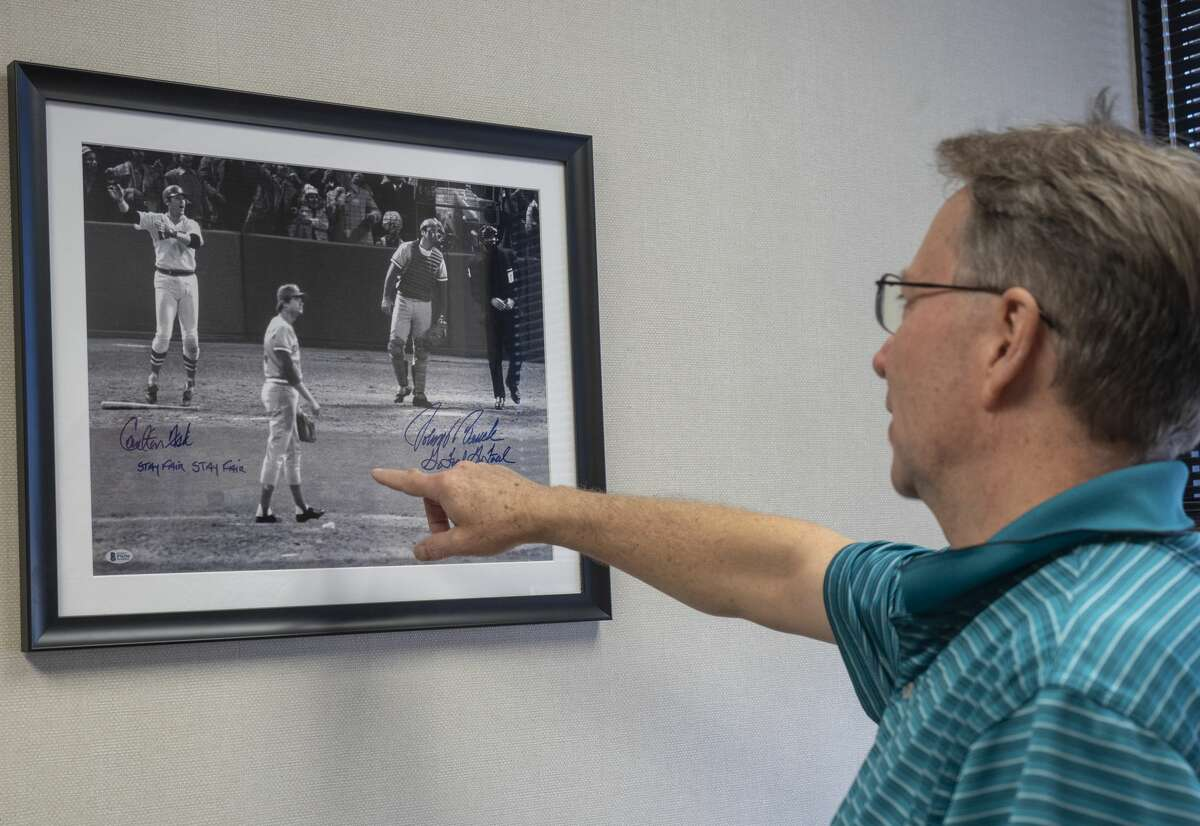 Michael Banschbach talks about a signed photo from the 1975 World Series game where Carlton Fisk watches his hit stay fair for a walk-off homerun as Reds pitcher, Pat Darcy and Johnny Bench, catcher, hope it goes foul.