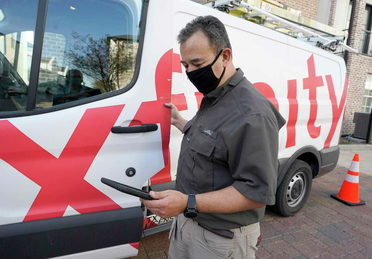 Luis Rodriguez, Xfinity comp tech supervisor, is shown Thursday, March 4, 2021 in Houston. Texas Education Agency officials are targeting a new, unprecedented goal in the coming years to ensure all public-school students have at-home broadband internet.