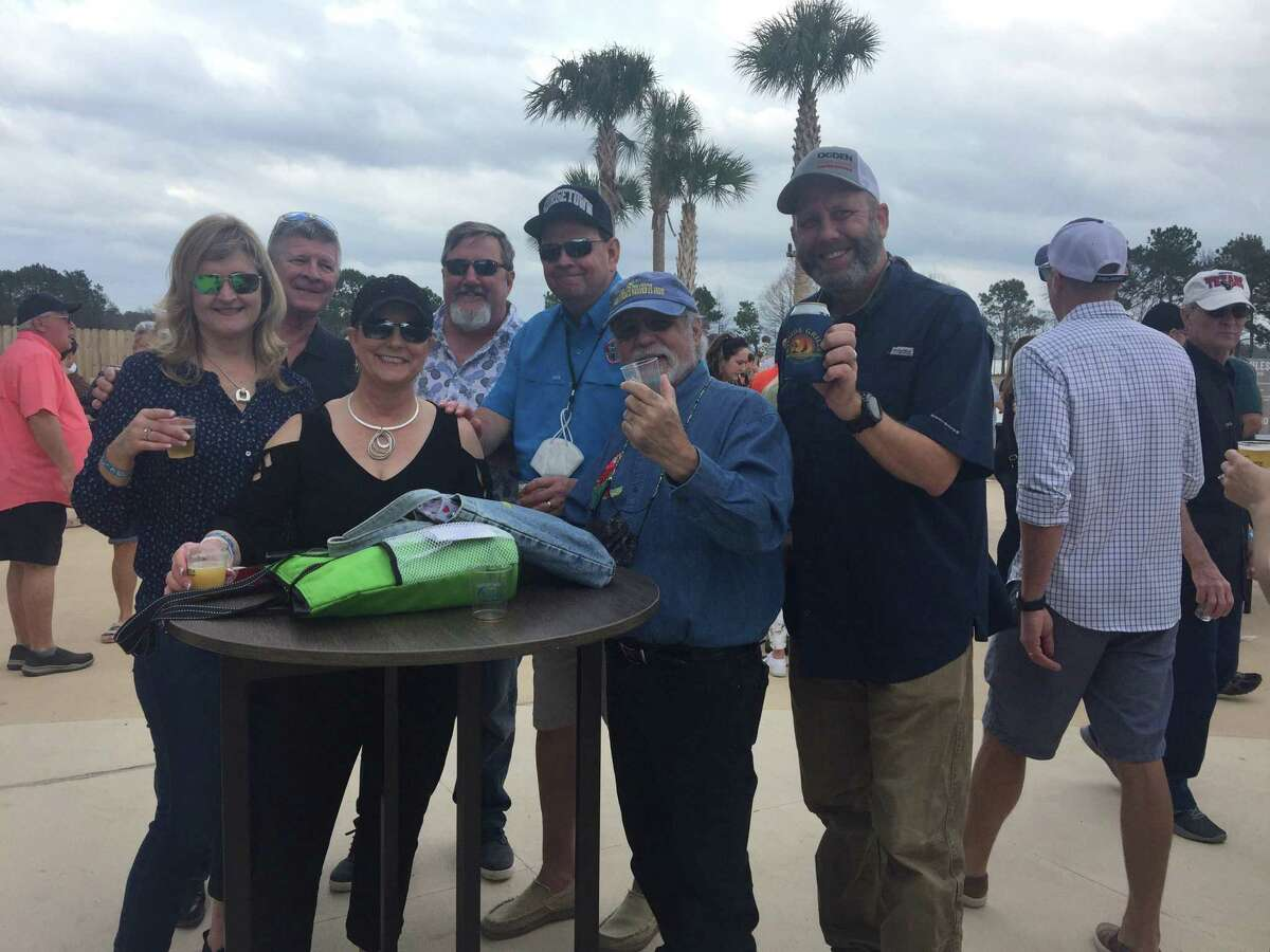 Michael McBride, center, is pictured with members of the 5 O'Clock Phlock Parrothead Club at the kick off for Texas Brewery Tours from Margaritaville on Feb. 27. The club is now based at Margaritaville.