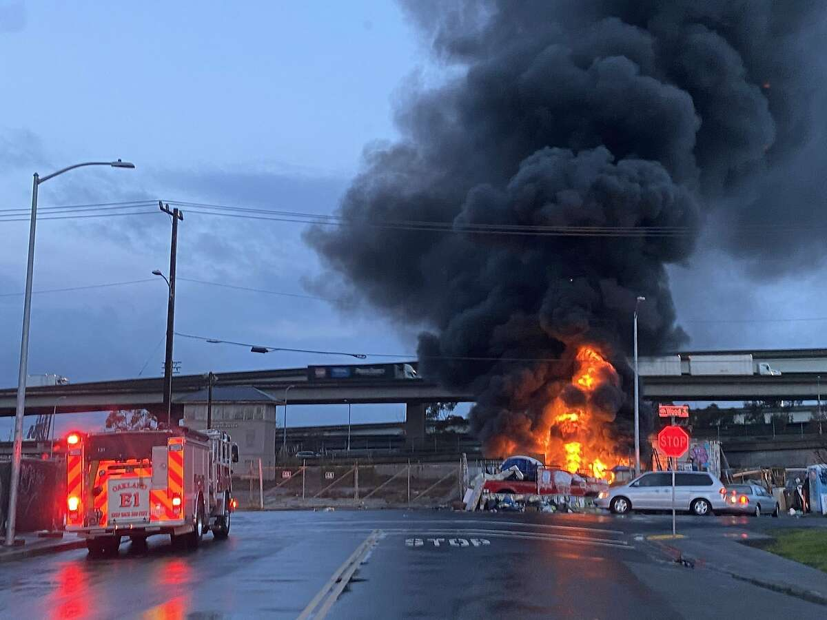 Oakland firefighters responded to a fire at an encampment at Wood and 18th streets Wednesday morning
