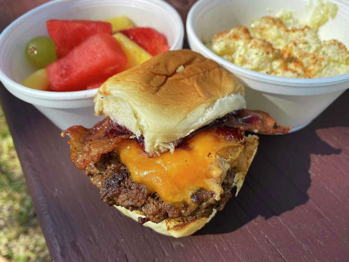 The Goobster slider includes crunchy peanut butter, grape jelly, bacon and cheddar at Slider Provider. Side options include mixed fruit and potato salad.