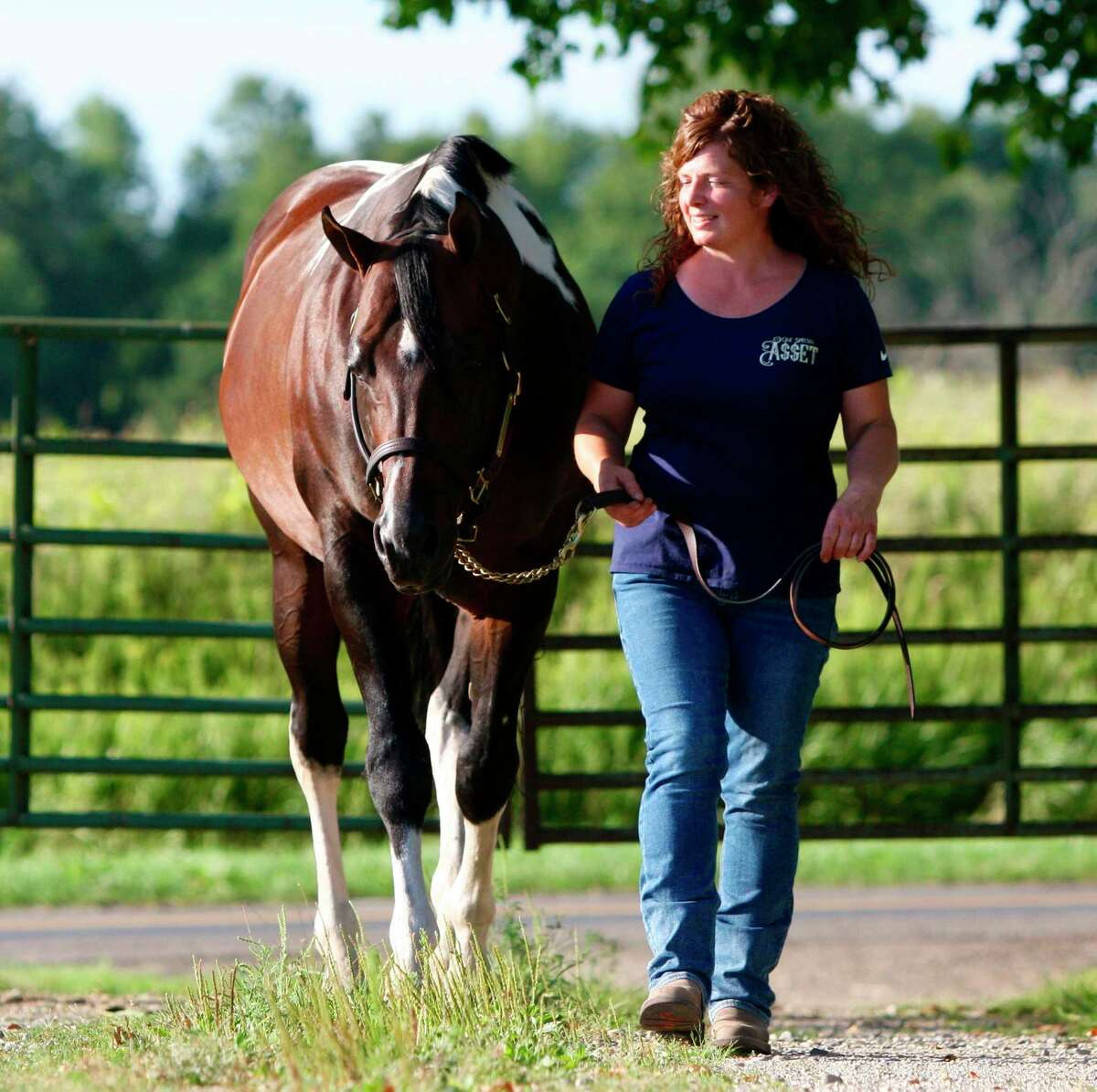 Theresa Rorabaugh takes a stroll with world-champion paint sire, One Special Asset. (Photo courtesy/Theresa Rorabaugh)