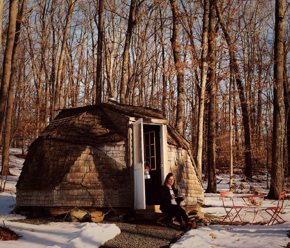 """Nicole Desanti photographed in the """"geodesic dome"""" at Sun One Organic Farm in Bethlehem, Conn. on March 4, 2021. The dome is available to book via Airbnb."""